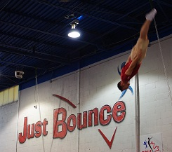 Athlete doing a layout at Just Bounce Trampoline Training Centre in Toronto